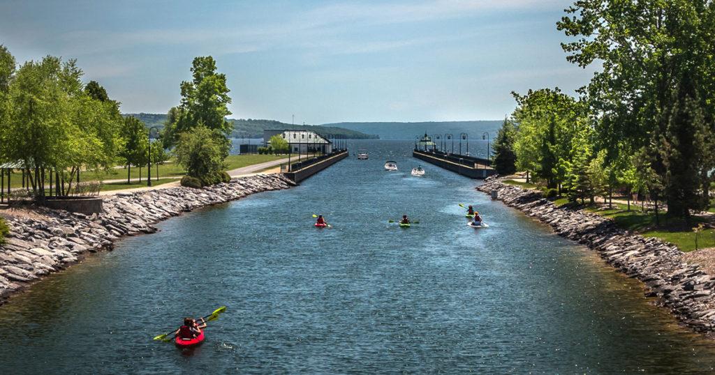 Kayakers paddling on Owasco River towards Owasco Lake. Photo by Chris Molloy.
