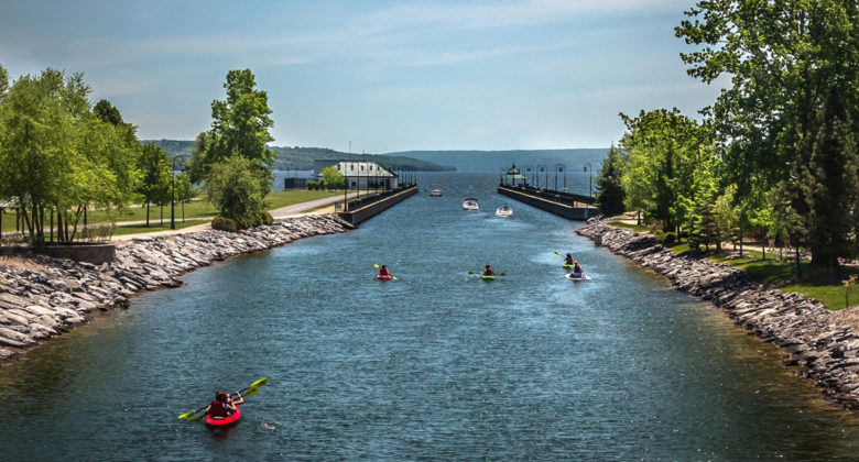 Kayakers paddling on Owasco River towards Owasco Lake. Photo by Chris Molloy.