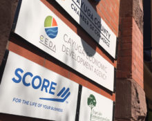 Cayuga Economic Development Agency and Auburn SCORE signs at 2 State Street, Auburn, NY