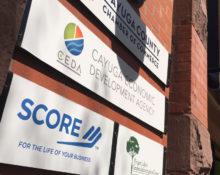 Cayuga Economic Development Agency and Auburn SCORE signs at 2 State Street, Auburn, NY