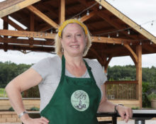 Susanne 'Cookie' Wheeler, owner of Custom Roots Catering, poses for a portrait near the stage at Treleaven Winery in King Ferry. Along with providing the lunch menu at the winery, Cookie runs the concession stand for the winery's events.
