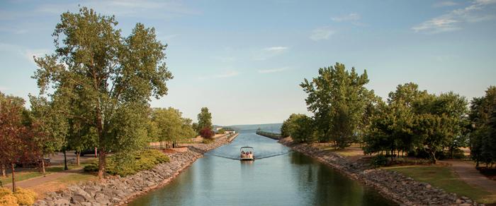 A boat enters the Owasco River from Owasco Lake in Auburn, NY. Photo courtesy of Jimmy Giannettino.